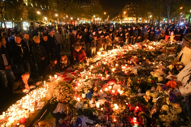 Dozens_of_mourning_people_captured_during_civil_service_in_remembrance_of_November_2015_Paris_attacks_victims._Western_Europe,_France,_Paris,_place_de_la_République,_Nov